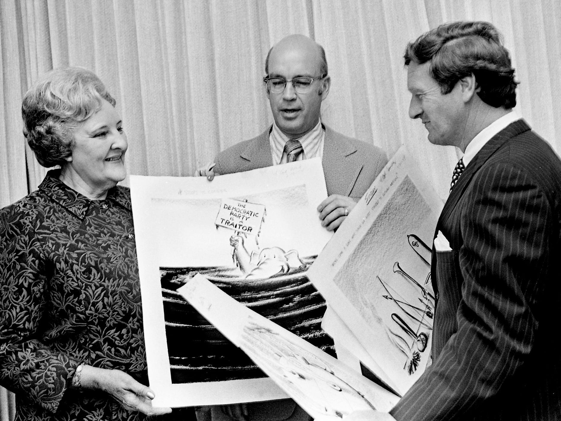 Mrs. Tom Little, left, with Frank Grisham, director of the Joint University Library, and John Seigenthaler, publisher of The Tennessean, looks at some of the 5,000 editorial cartoons by her late husband May 4, 1963. All of them were published in The Tennessean, and all were presented to the JUL at Vanderbilt for use of researchers.