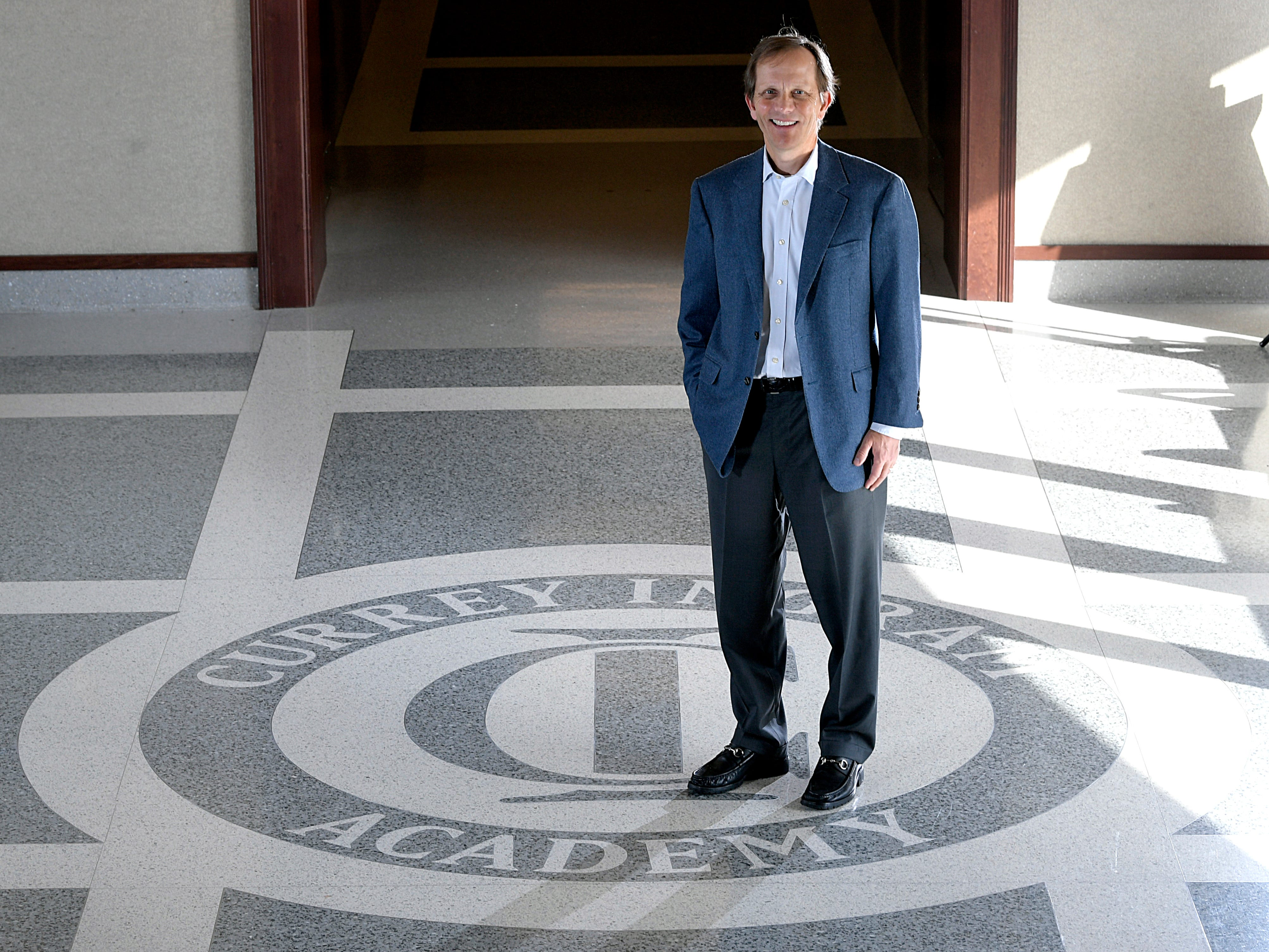 John Ingram stands in the hallway of Currey Ingram Academy in Brentwood on Jan. 8, 2019.  Ingram and his wife, Stephanie Currey Ingram, helped financially build the private school's 83-acre campus in 2002.