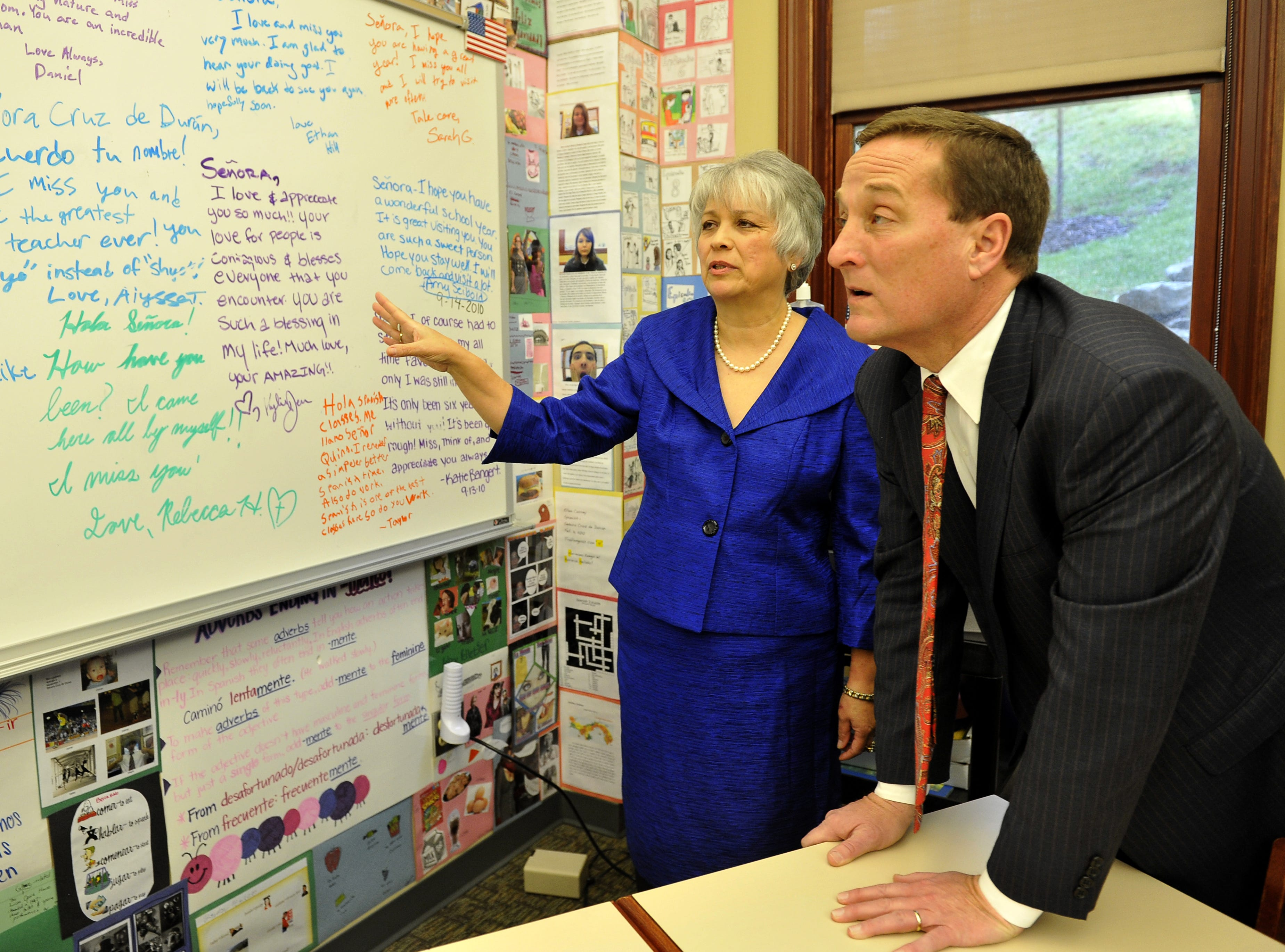 Spanish teacher Rita Cruz de Duran shows her classroom to Don MacLachlan, executive vice president of the Tennessee Titans, after she received an award for being named the Titans teacher of the year during a ceremony at Currey Ingram Academy in 2011.