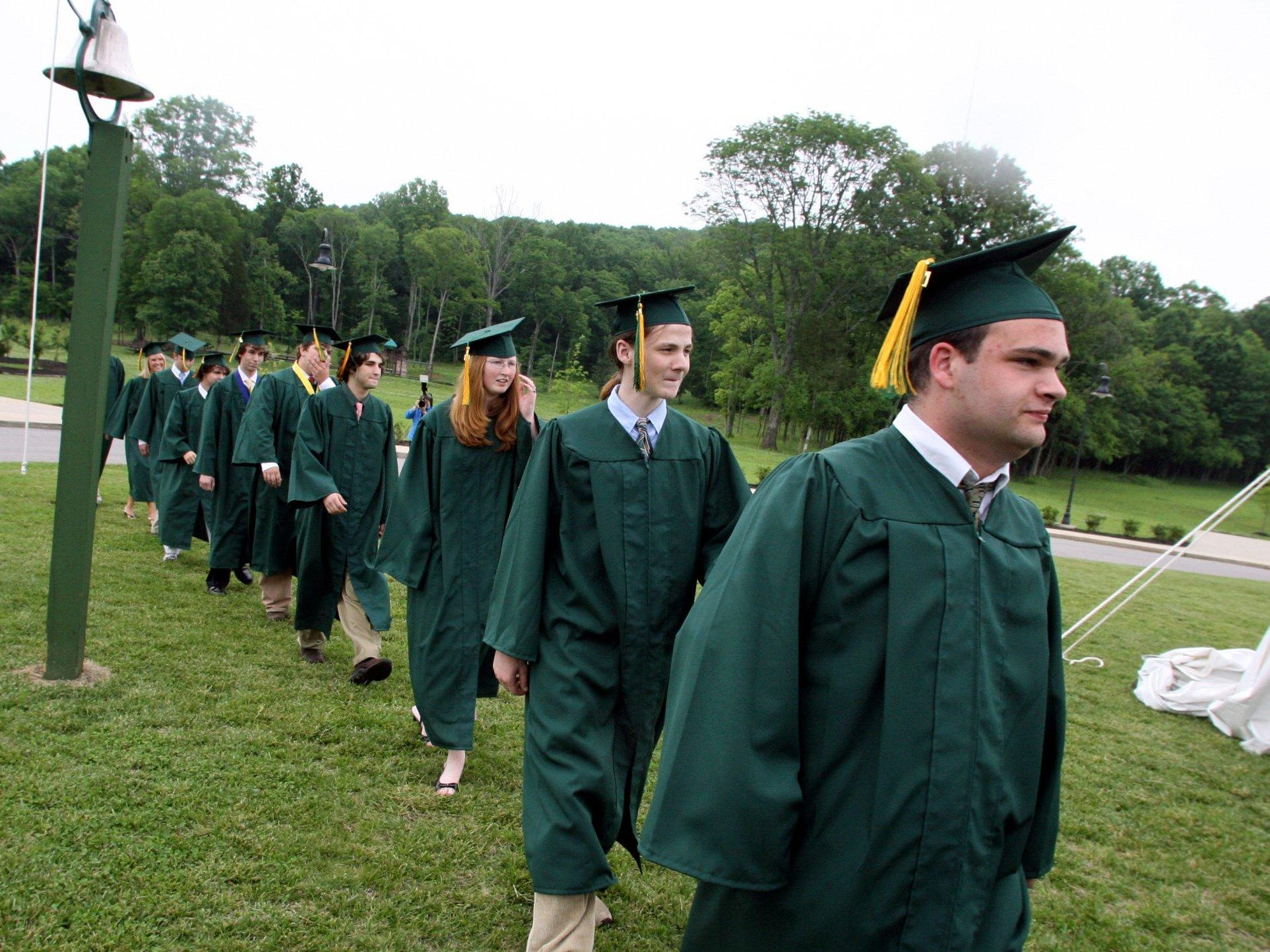 Cory Hulan, right, and the rest of the Currey Ingram Academy senior class walk to the tent where graduation is held in 2006.