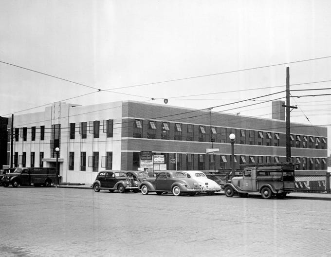 Several cars are parked outside The Tennessean building at 1100 Broadway at the Broadway viaduct Nov. 26, 1941.