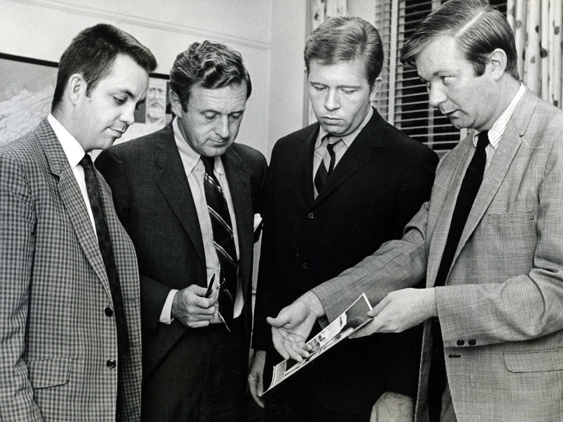 John Seigenthaler, second from left, talks with Tennessean staff members Frank Ritter, left, Jim Squires and John Hemphill at the office Sept. 10, 1969.