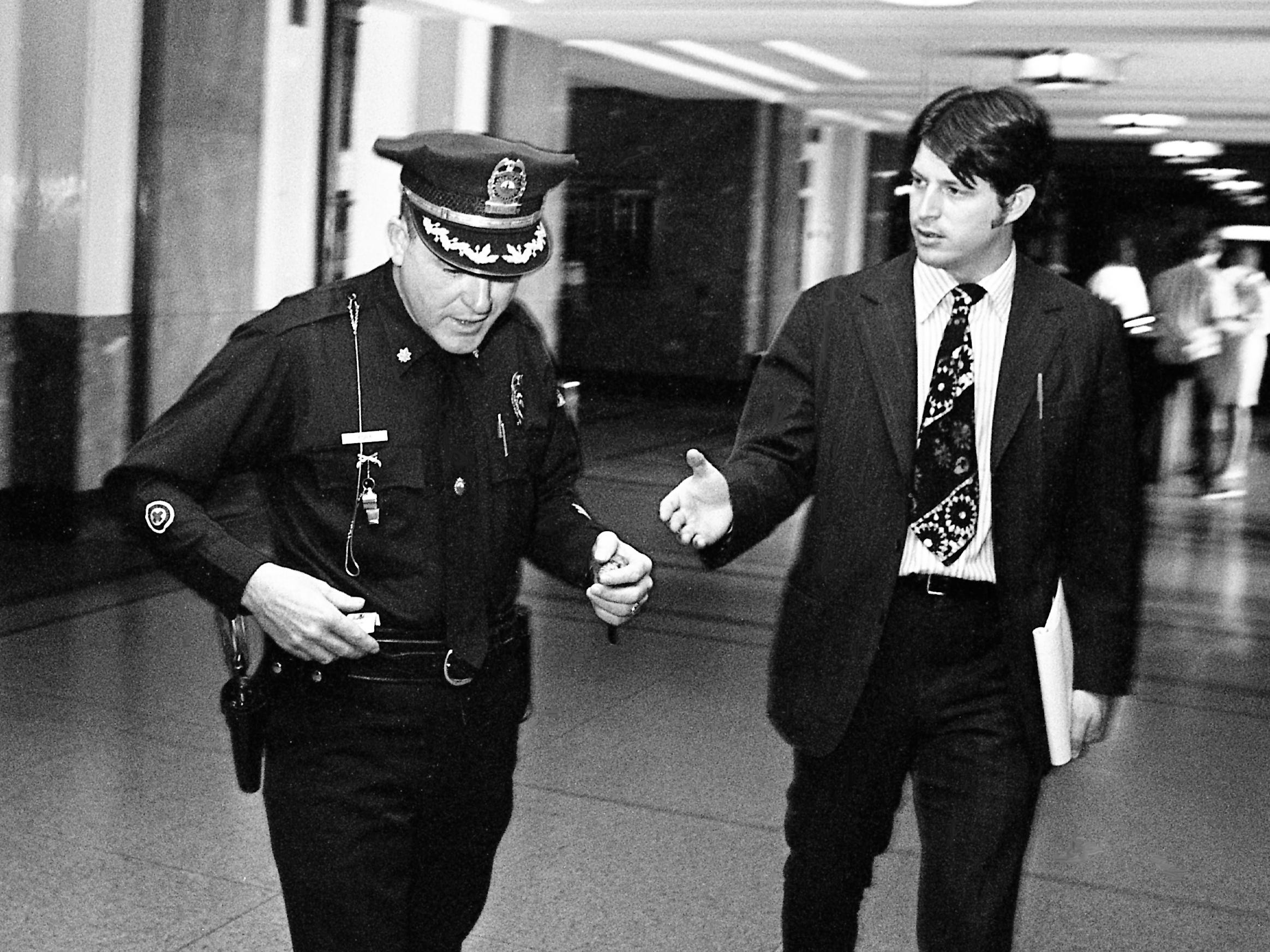 Metro police Maj. James A. York, left, declines to answer questions from Tennessean reporter Al Gore Jr. as he leaves the Davidson County grand jury room at the Metro Courthouse on Oct. 12, 1973. York was subpoenaed to testify about his knowledge of the department's internal investigation of alleged criminal activity by Metro police officers.