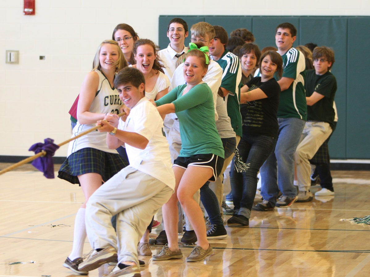 Currey Ingram Academy students celebrate the opening of the new gym with a game of tug of war in 2010.