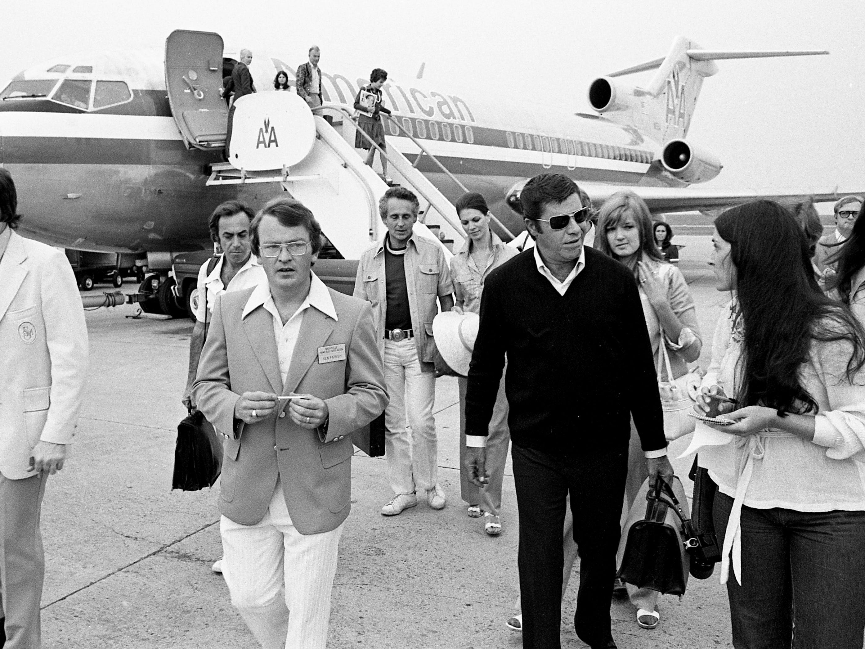 Comedian Jerry Lewis, second from right, is interviewed by Tennessean reporter Natilee Duning after arriving in Nashville on Aug. 2, 1974, for a couple of muscular dystrophy events.