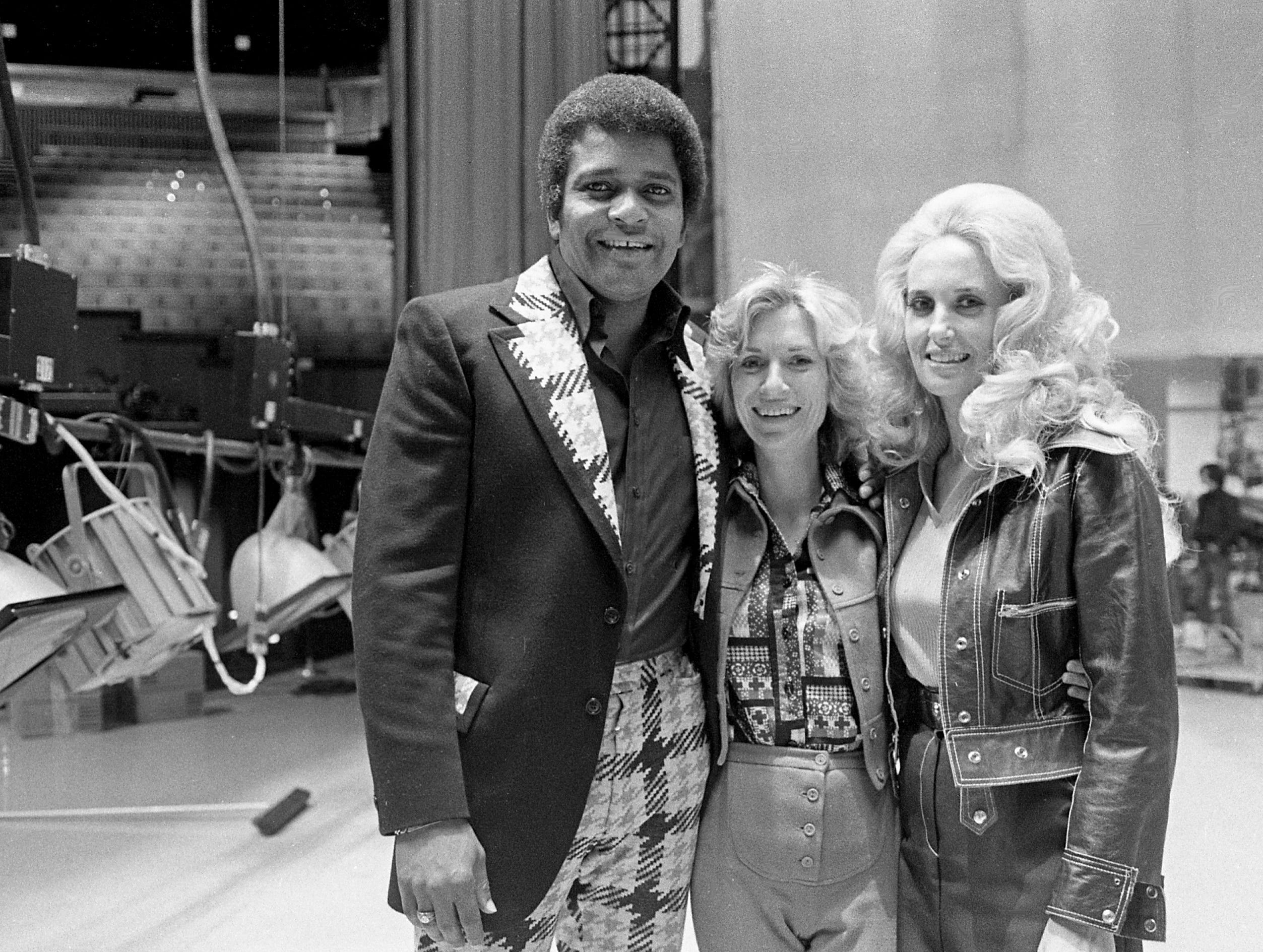 Tennessean reporter Lynn Harvey, center, poses with country music stars Charley Pride and Tammy Wynette on the stage of the Grand Ole Opry House on Jan. 14, 1975.