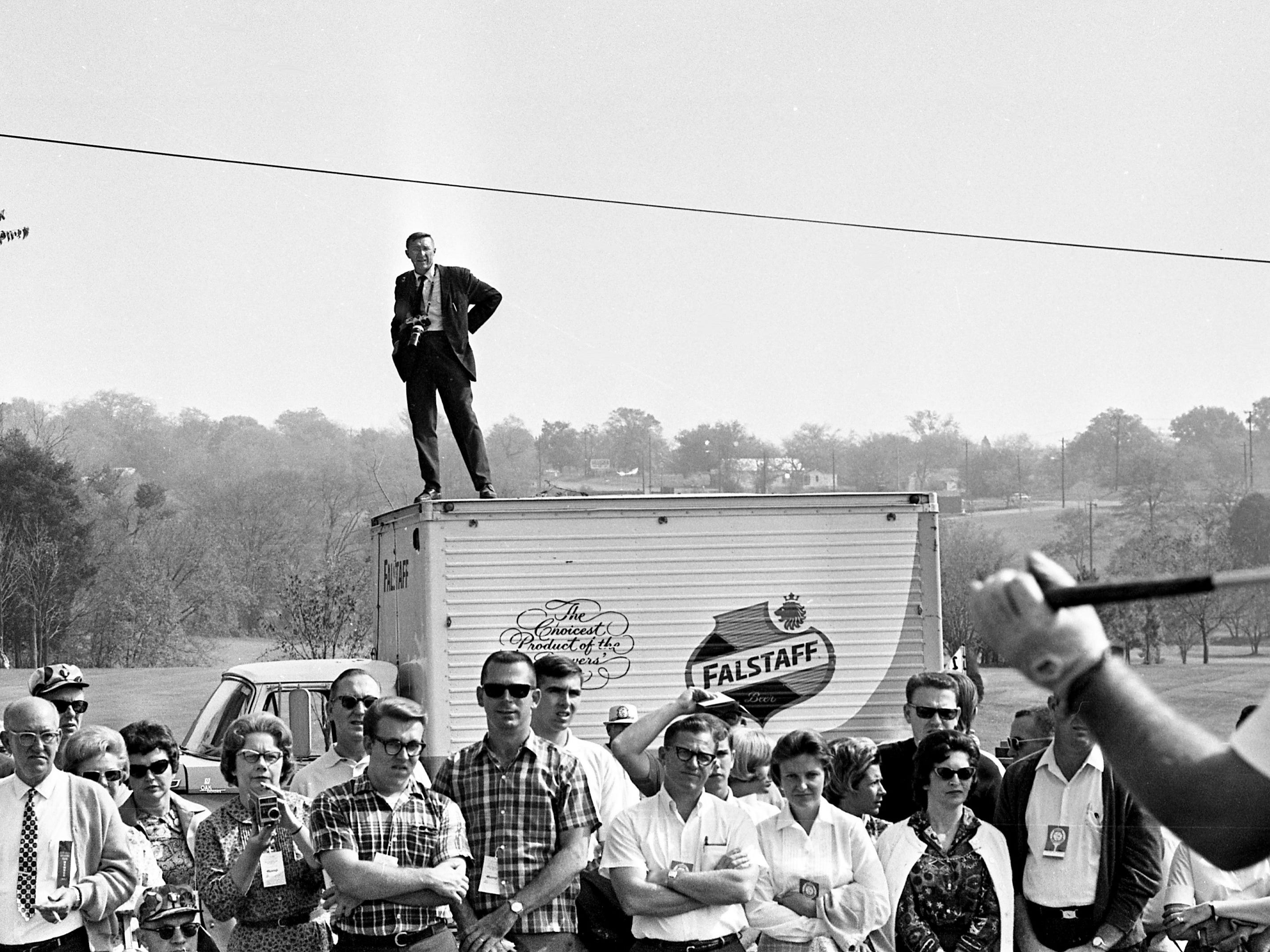 Tennessean photographer Joe Rudis finds a better spot to cover the first day of the third annual Music City USA Pro-Celebrity Golf Tournament on Oct. 14, 1967, at Bluegrass Country Club.