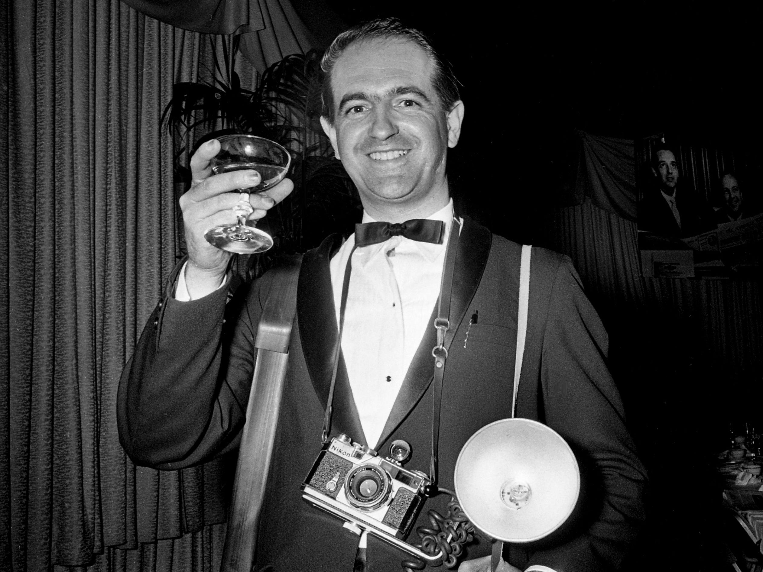 Tennessean staff photographer Frank Epson gives a toast at the end of the tribute dinner honoring the 30th anniversary of the Silliman Evans family as publishers of The Tennessean on April 6, 1967, at Municipal Auditorium.