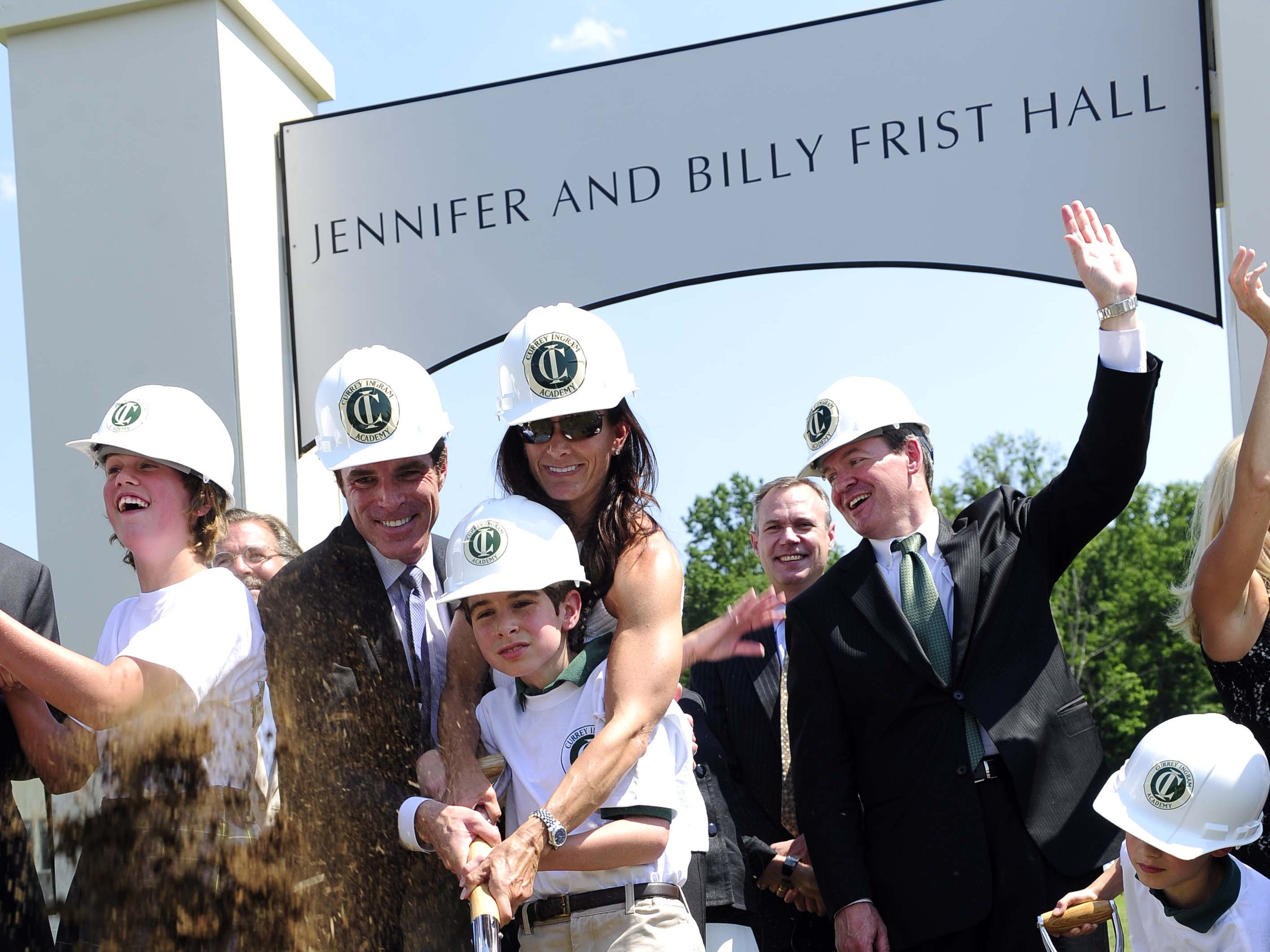 Billy and Jennifer Frist break ground with their son Walker Frist during the ceremony for a new student center at Currey Ingram Academy on May 16, 2012.