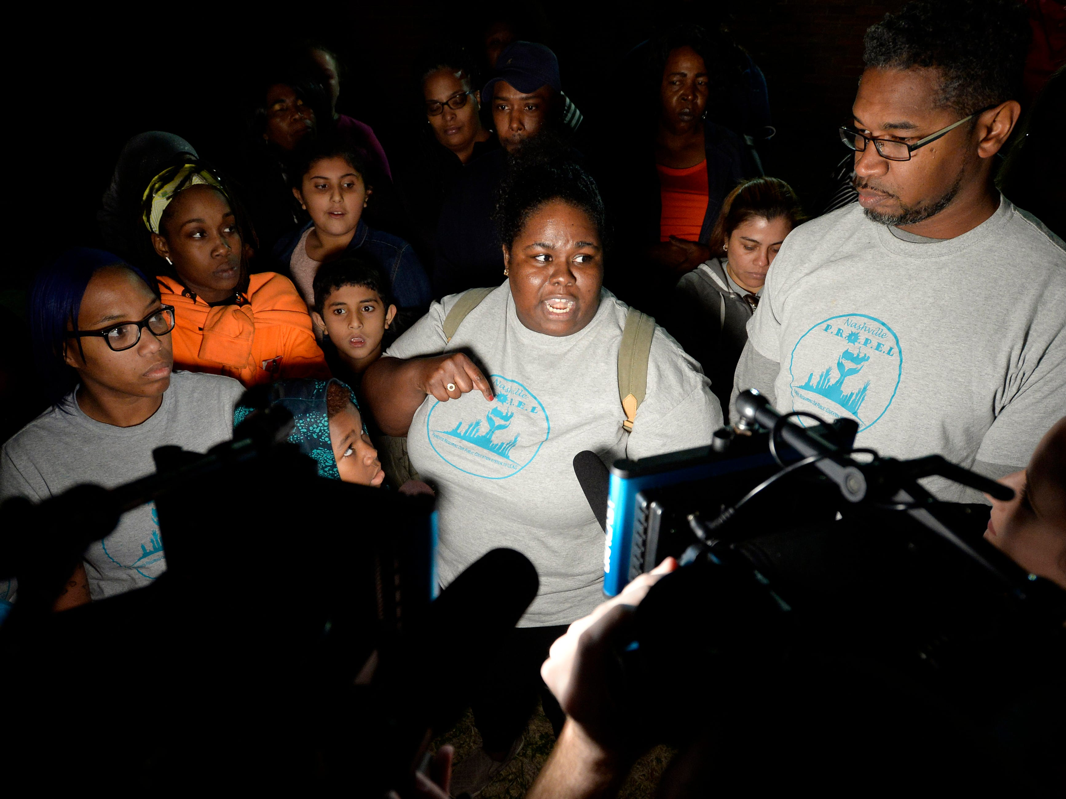 Liz Lyons, center, speaks outside the Metro Nashville Public School building explaining why a group of parents walked out of the Metropolitan Nashville Public Board of Education board meeting on Tuesday, Jan. 8, 2019, in Nashville, Tenn. Lyons said because parents became angry when board members did not talk about the quality of education their children need.