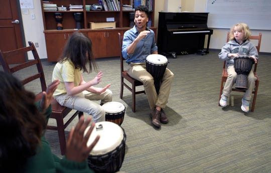 Currey Ingram Academy drama and music teacher Terell Davy teaches students how to play in a drum circle on Tuesday, Jan. 8, 2019.