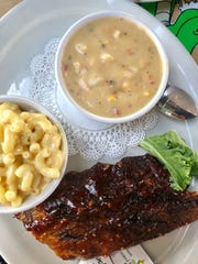 A half-rack of ribs slicked in sauce, with a side of mac and cheese and the Bonita Beach Balloon's seafood and roasted corn chowder.
