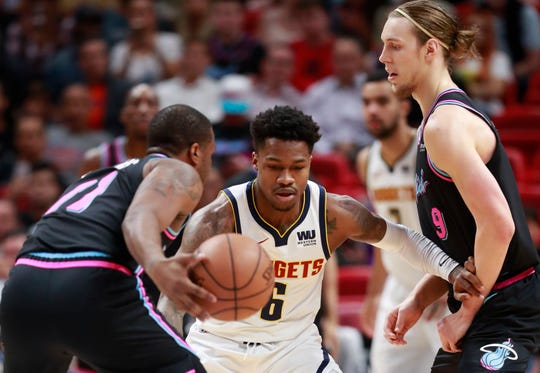Denver Nuggets guard Brandon Goodwin (6) defends against Miami Heat guard Dion Waiters (11) and forward Kelly Olynyk (9) during the first half of an NBA basketball game, Tuesday, Jan. 8, 2019, in Miami. (AP Photo/Wilfredo Lee)