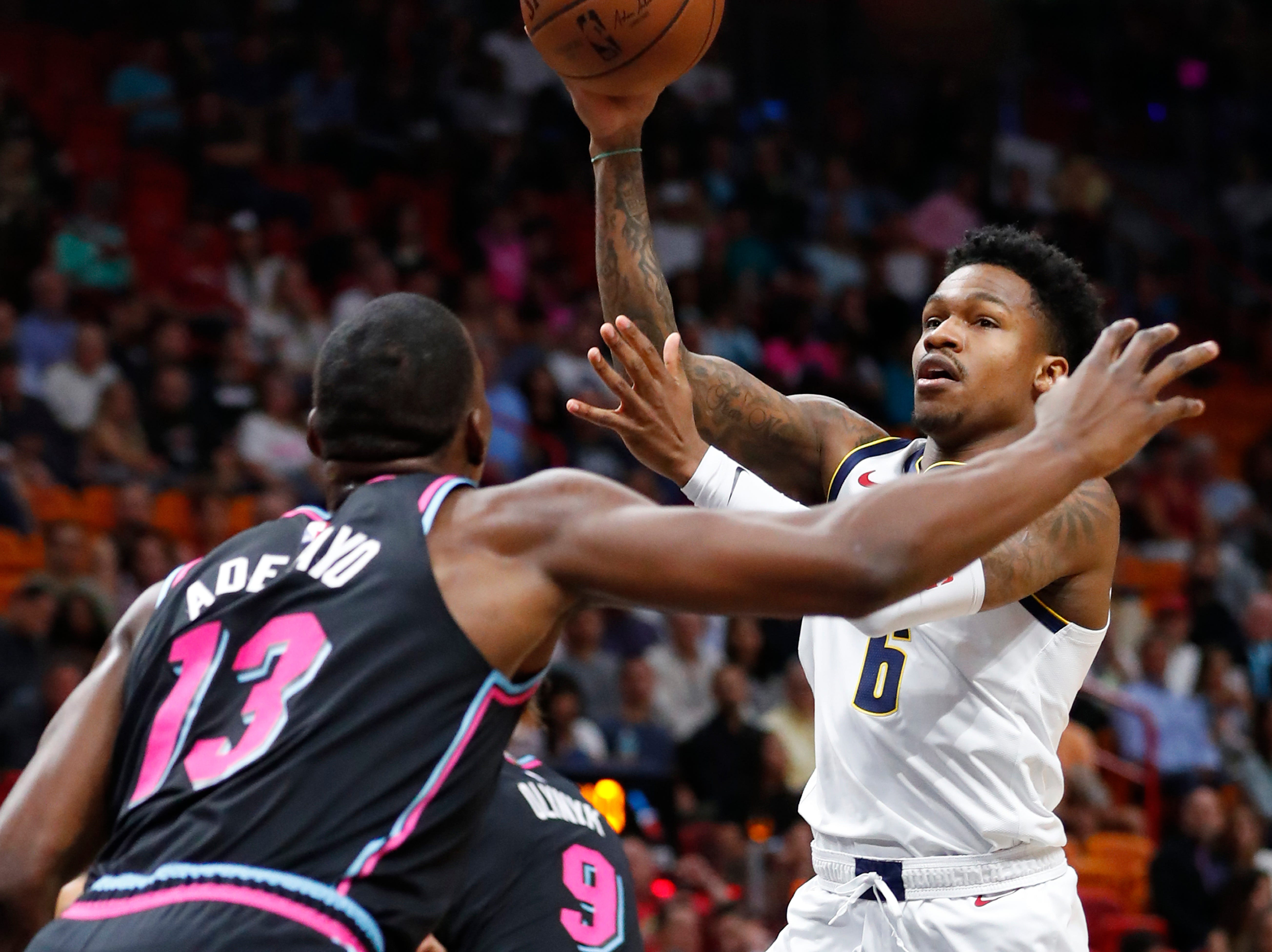 Denver Nuggets guard Brandon Goodwin (6) makes a pass against Miami Heat center Bam Adebayo (13) during the first half of an NBA basketball game against the Miami Heat, Tuesday, Jan. 8, 2019, in Miami. (AP Photo/Wilfredo Lee)