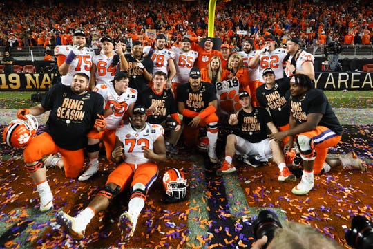 First Baptist Academy graduate Seth Penner, far left in T-shirt, poses with his Clemson Tigers teammates after the 2019 College Football Playoff Championship game against the Alabama Crimson Tide at Levi's Stadium. Clemson won, 44-16. Penner played the final two plays in his last college game.