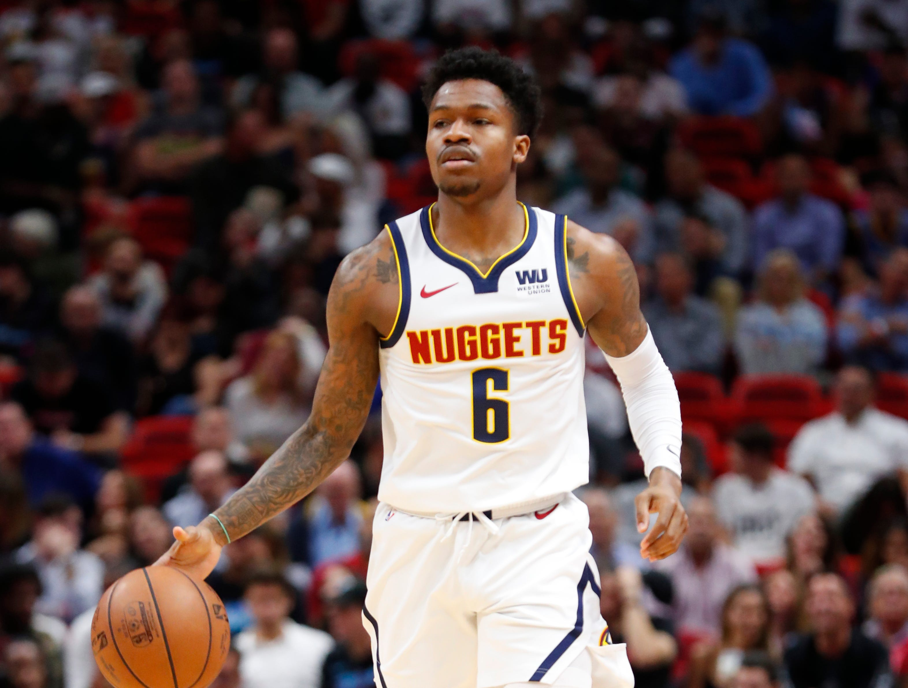 Denver Nuggets guard Brandon Goodwin takes the ball down court during the first half of an NBA basketball game against the Miami Heat, Tuesday, Jan. 8, 2019, in Miami. (AP Photo/Wilfredo Lee)
