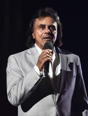 "Recording artist Johnny Mathis performs onstage during the MPTF 95th anniversary celebration with ""Hollywood's Night Under The Stars"" at MPTF Wasserman Campus on Oct, 1, 2016 in Los Angeles."