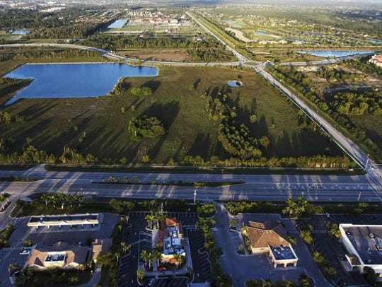 Looking east across U.S. 41 in Estero, with Williams Road to the right and Via Coconut Point in the middle background, at the 100-acre plot of land HCA bought for $52.5 million.
