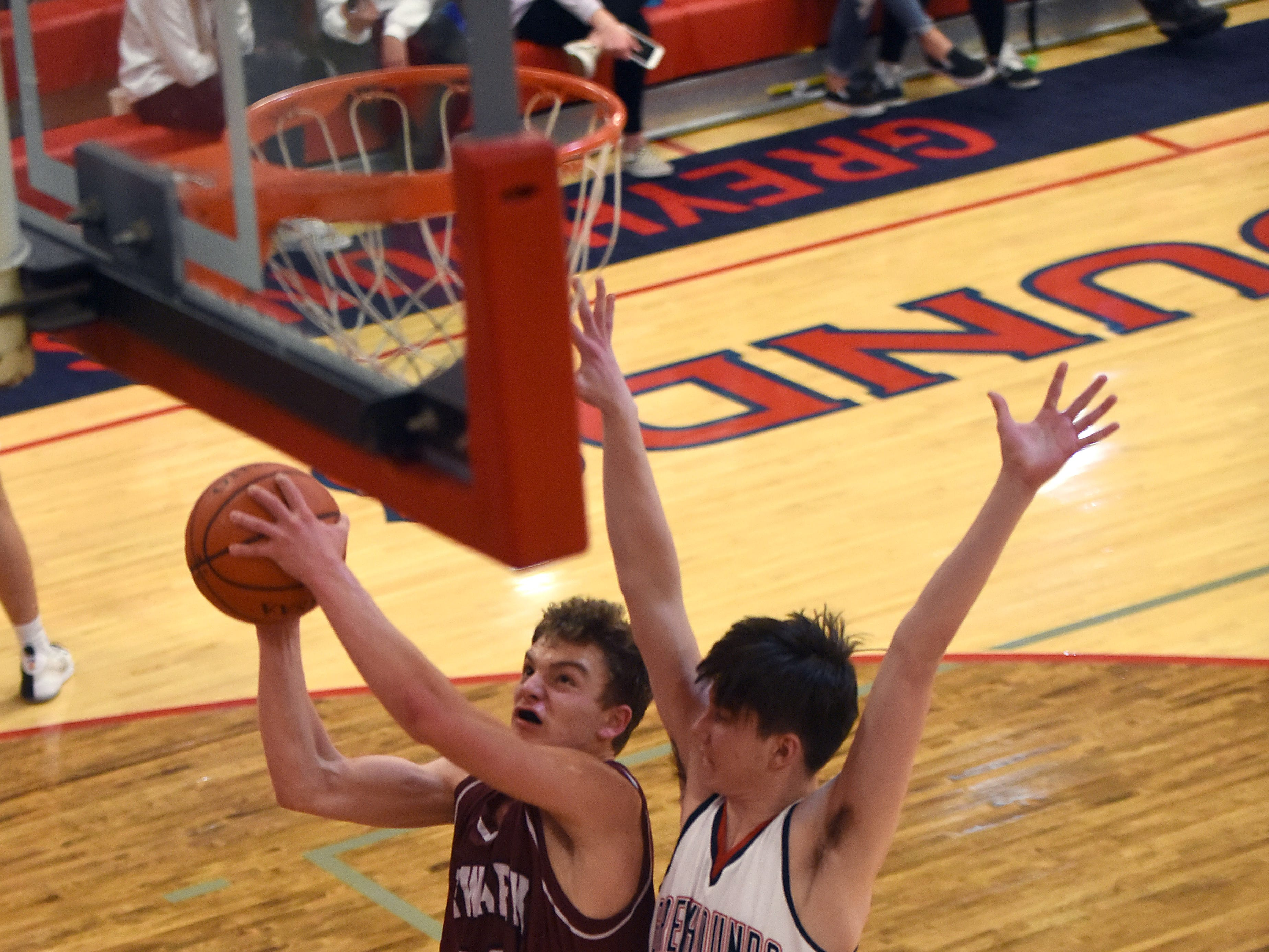 Newark sophomore Kade Bafford takes a shot against defense from Grove City sophomore Michael Hooffstetter during Tuesday night's game at Grove City. The Wildcats won 61-47 on the road.