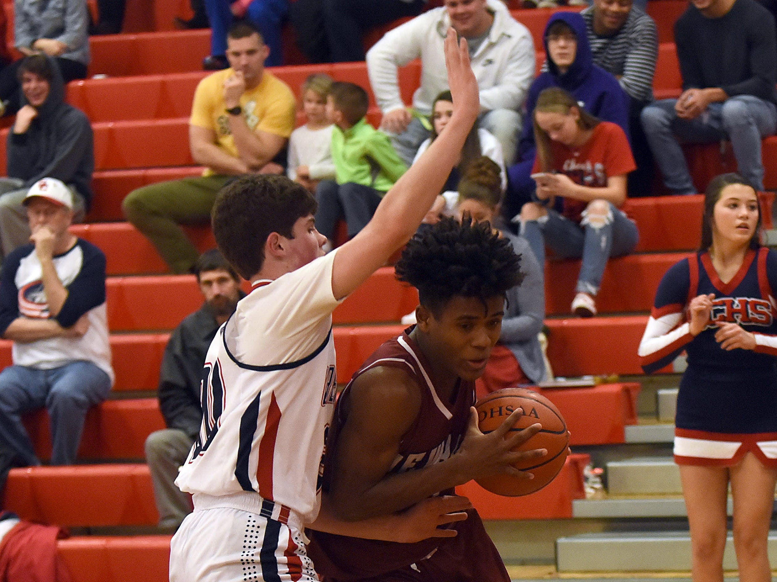Grove City sophomore Alex Coffey guards Newark junior Bobby Crenshaw during Tuesday night's game at Grove City. The Wildcats won 61-47 on the road.