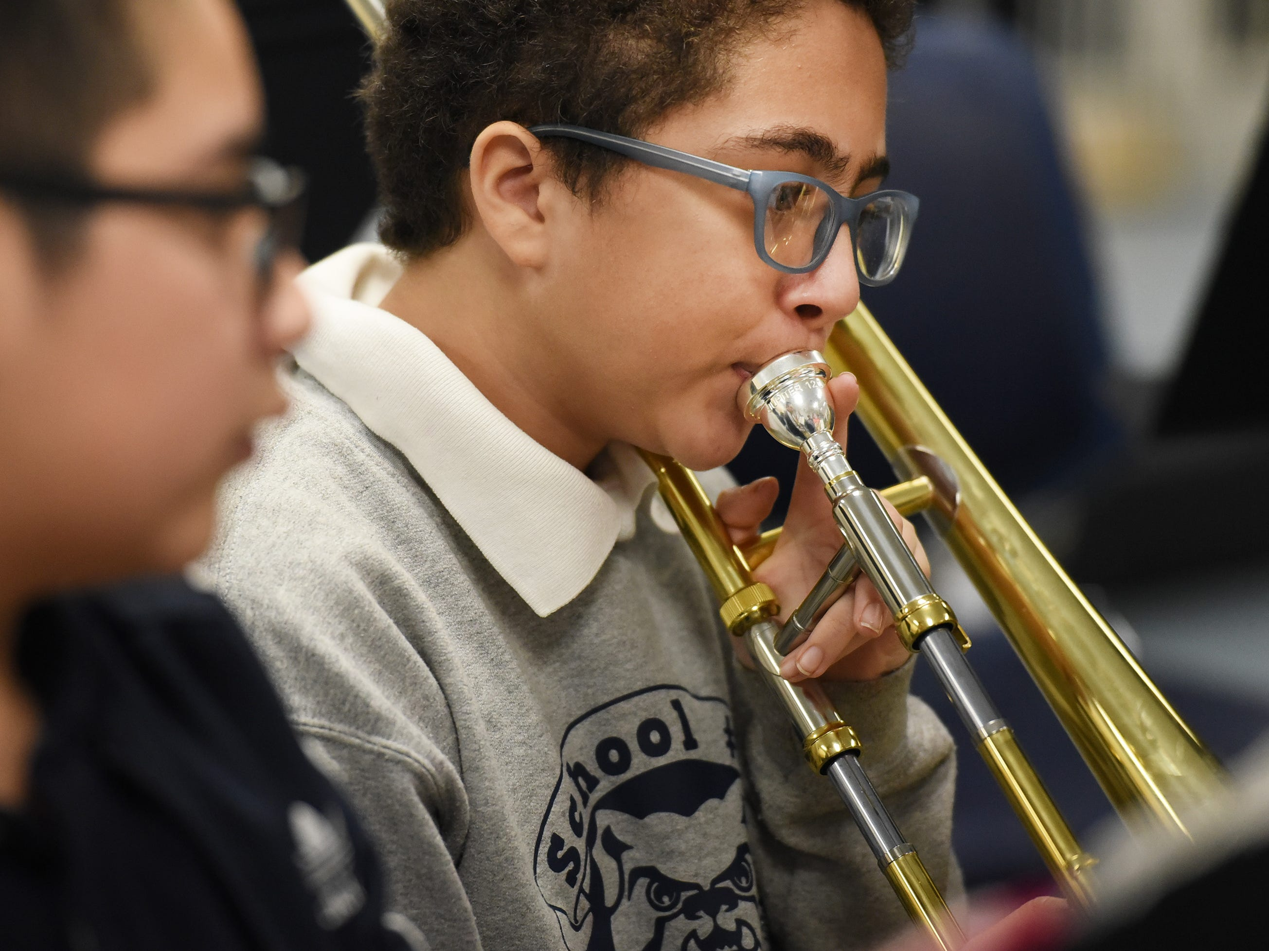 Seventh grader Bryan Castillo plays his trombone as he and his teammates practice led by the Band Director Nancy Horowitz during a music class at School #24 in Paterson on 01/09/19.