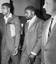 "May 27, 1967, original caption: John Artis, left, and Rubin ""Hurricane"" Carter walk manacled together from the court room.  The jury had just found them guilty of first degree murder."