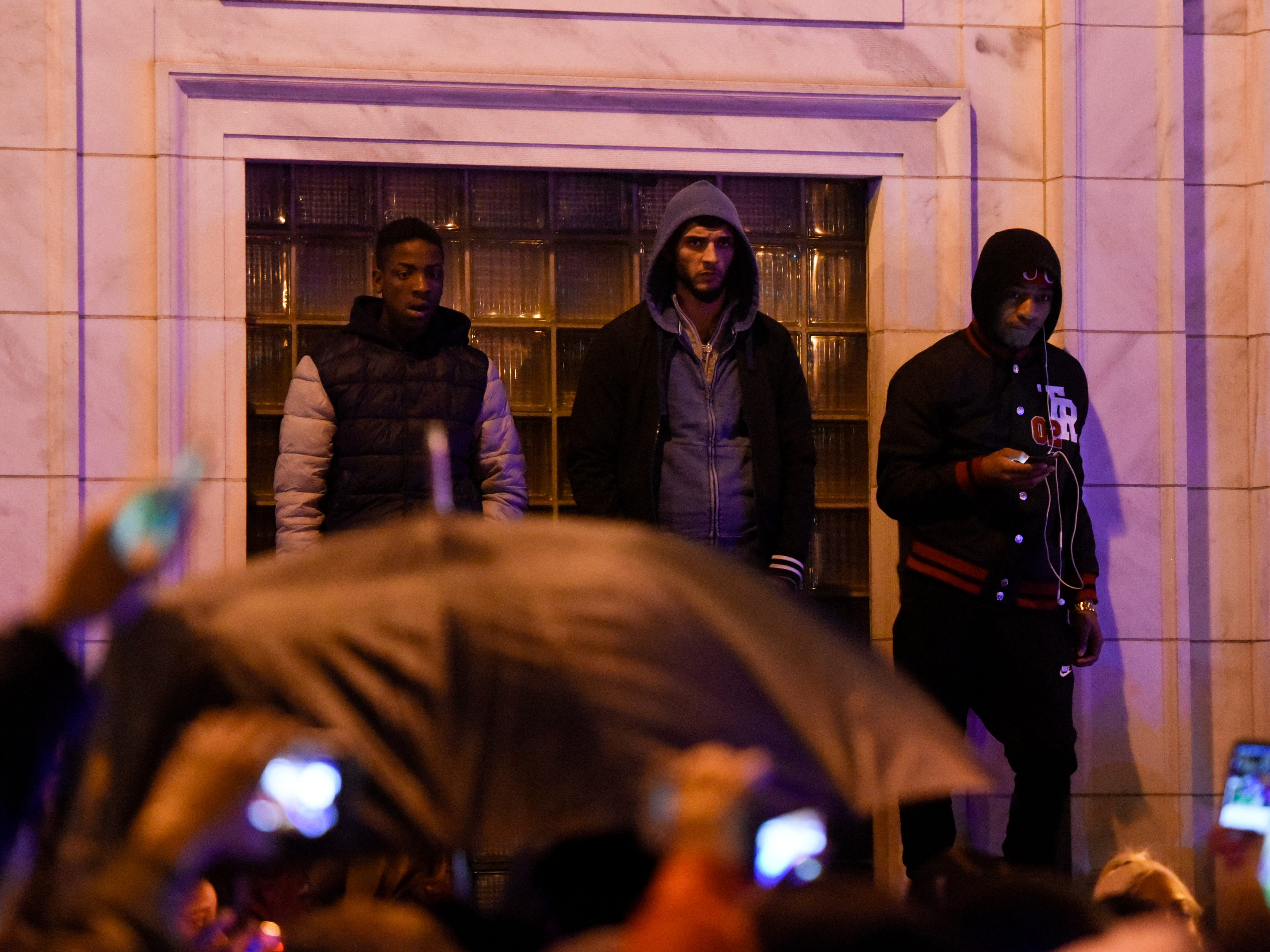 Men stand on a ledge during a protest at Paterson City Hall in reaction to the death of Jameek Lowery on Tuesday, Jan. 8, 2019, in Paterson. Lowery died two days after going on Facebook Live claiming that someone was out to kill him and asking the Paterson Police Department for help.