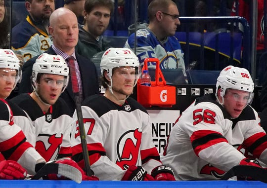 New Jersey Devils head coach John Hynes watches play during the first period against the Buffalo Sabres at KeyBank Center.