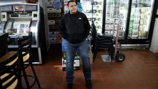 """VIDEO THUMBNAIL ONLY---------------------------------Euclides Moya Jr. 23, is the manager of Moya E. Bar-Liquors in Paterson. The store is the site of the infamous 1966 shooting that put famed boxer, Rubin """"Hurricane"""" Carter, in jail for approximately 20  years.  Moya says customers talk about the shooting often. Wednesday, January 9,  2019"""