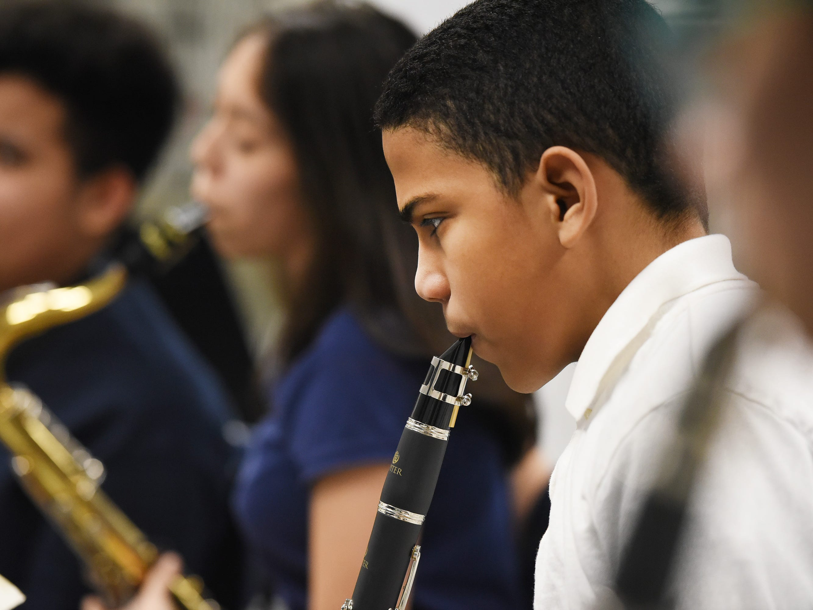 Seventh grader Odivis Cepeda plays his clarinet as he and his teammates practice led by the Band Director Nancy Horowitz during a music class at School #24 in Paterson on 01/09/19.