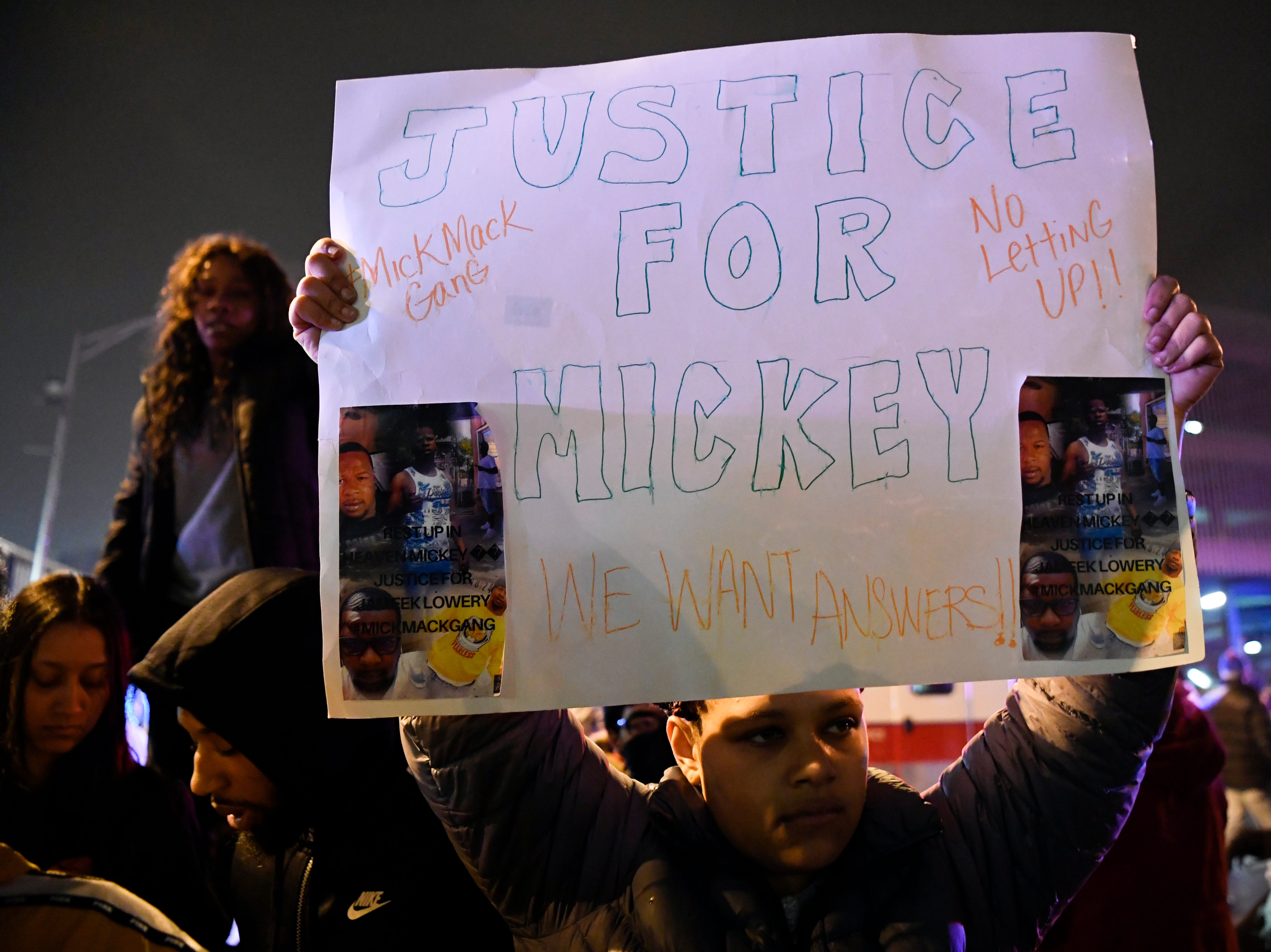 A woman holds a sign for Jameek Lowery during a rally on Tuesday, Jan. 8, 2019, in Paterson. Lowery died two days after going on Facebook Live claiming that someone was out to kill him and asking the Paterson Police Department for help.