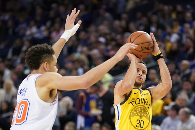 January 8, 2019; Oakland, CA, USA; Golden State Warriors guard Stephen Curry (30) shoots the basketball against New York Knicks forward Kevin Knox (20) during the third quarter at Oracle Arena.