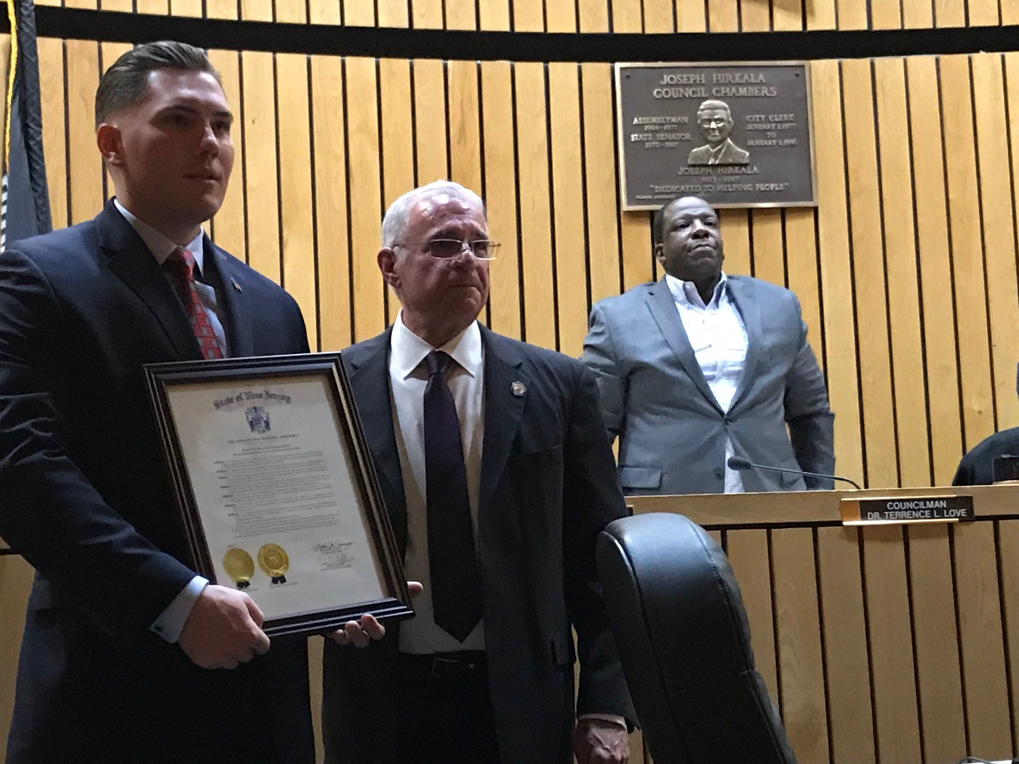 Tyler Hanson receiving a proclamation from the state of New Jersey from City Council President/State assemblyman Gary Schaer of rhis heroic actions on Dec. 31. Hanson rescued a Passaic family froma burning building.