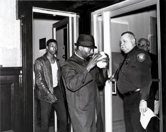 Undated: Rubin Carter and John Artis with police.