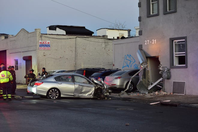 A Honda sedan crashed into a building on First Ave in Paterson, on Wednesday January 9, 2019. The driver was extricated and sent to the hospital.