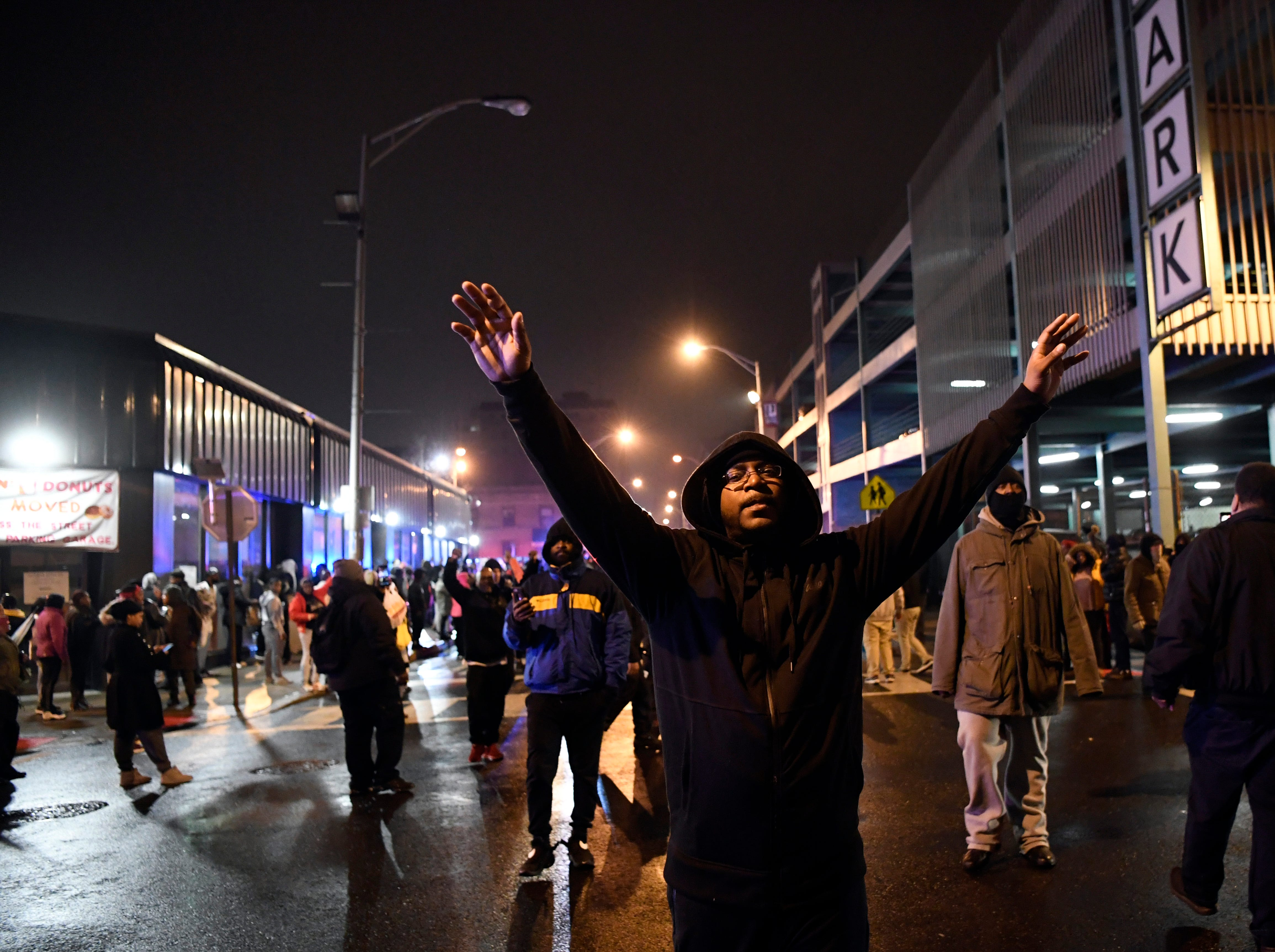 A man approaches the police line with his hands up during a rally for justice for Jameek Lowery on Tuesday, Jan. 8, 2019, in Paterson. Lowery died two days after going on Facebook Live claiming that someone was out to kill him and asking the Paterson Police Department for help.