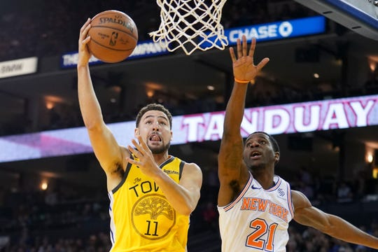 January 8, 2019; Oakland, CA, USA; Golden State Warriors guard Klay Thompson (11) shoots the basketball against New York Knicks guard Damyean Dotson (21) during the fourth quarter at Oracle Arena.