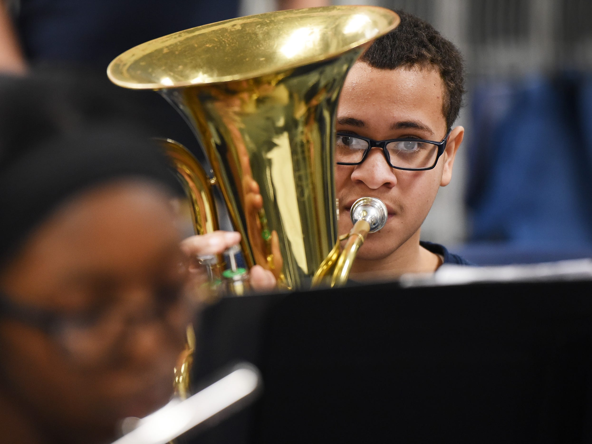 Eighth grader Pericles Gonzalez plays as he and his teammates practice led by the Band Director Nancy Horowitz during a music class at School #24 in Paterson on 01/09/19.