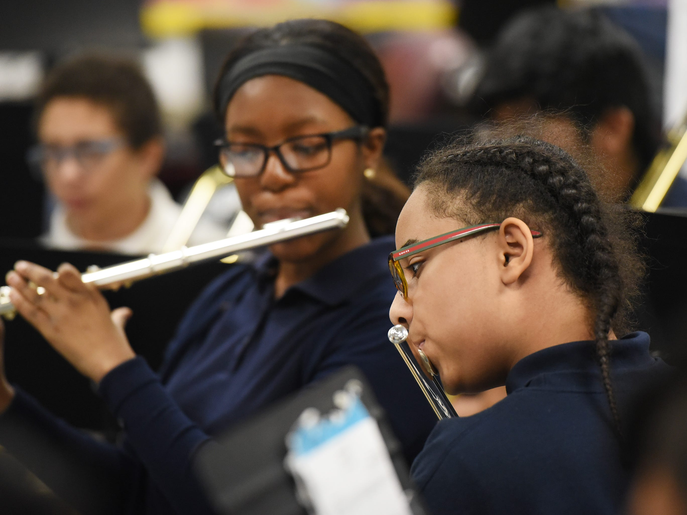 Aaliyah Nelson (rear, 8th) and Moises Grullon(foreground, 7th) play their flutes as they practice led by the Band Director Nancy Horowitz during a music class at School #24 in Paterson on 01/09/19.