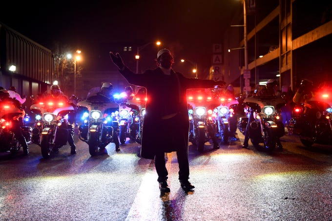A man stands in front of police motorcycles during a rally in the wake of the death of Jameek Lowery on Tuesday, Jan. 8, 2019, in Paterson. Lowery died two days after going on Facebook Live claiming that someone was out to kill him and asking the Paterson Police Department for help.