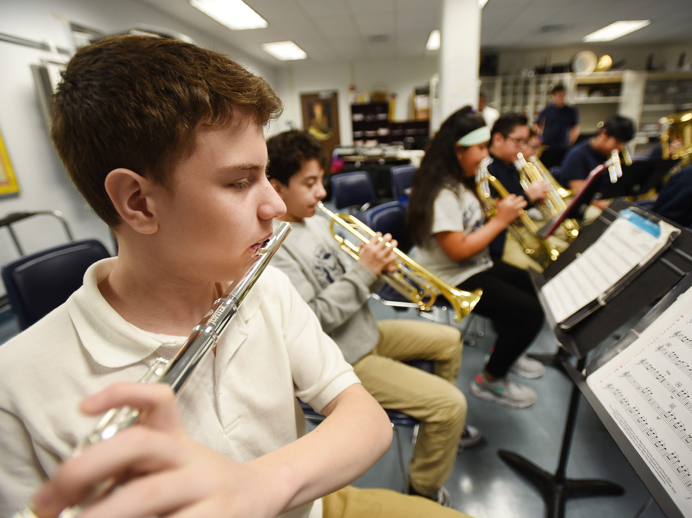 Seventh grader Esteban Henao plays his flute as he and his teammates practice led by the Band Director Nancy Horowitz during a music class at School #24 in Paterson on 01/09/19.