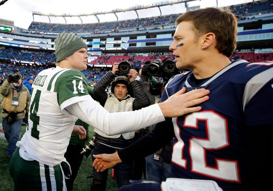Dec 30, 2018; Foxborough, MA, USA; New England Patriots quarterback Tom Brady (12) and New York Jets quarterback Sam Darnold (14) congratulate each other after New England's win at Gillette Stadium.
