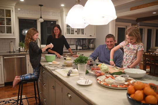 The Levison family, Michal and Zack stress the importance of family time with their daughters Bella, 10, and Anya, 7, by cooking dinner together at least twice a week. Bella, 10,  and Michal work on making meatballs while Zach and Anya, 7, are in charge of the salad for dinner on Tuesday, January 8, 2019. Not only does this allow for quality time together, the family bonds and make memories over a shared love of food.