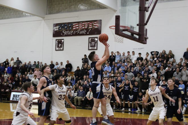 Senior Taylor Jackson going up for the game-winning buzzer-beater to lift Wayne Valley to a dramatic win over Wayne Hills.