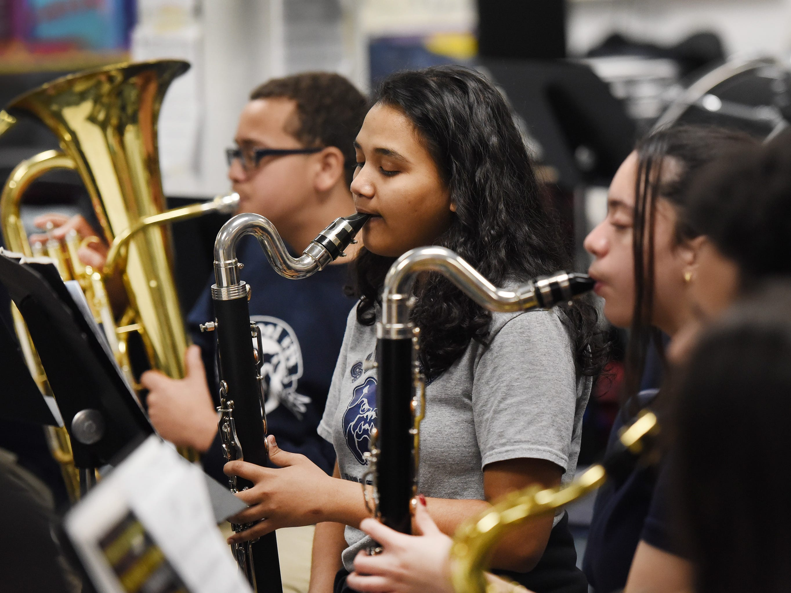 Eighth grader Papiya Malik plays her bass clarinet as they practice led by the Band Director Nancy Horowitz during a music class at School #24 in Paterson on 01/09/19.