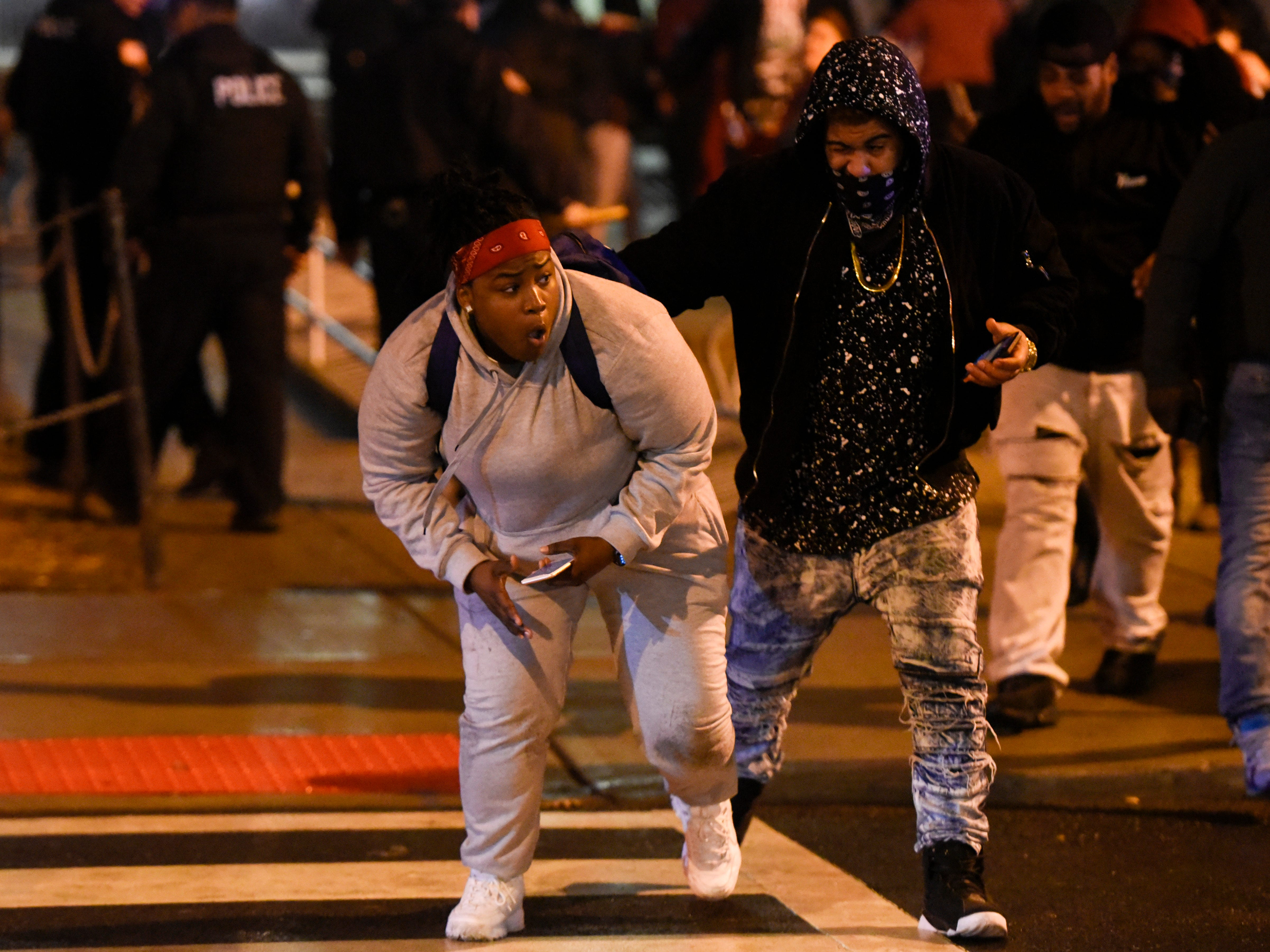 People run from Paterson police officers after being maced during a rally calling for justice for Jameek Lowery on Tuesday, Jan. 8, 2019, in Paterson. Lowery died two days after going on Facebook Live claiming that someone was out to kill him and asking the Paterson Police Department for help.