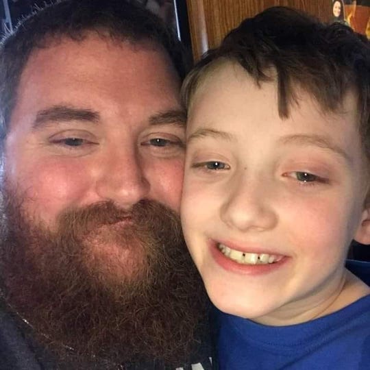 Justin Van de Voort and his son, Caleb, who died suddenly of an asthma attack on Jan. 7.