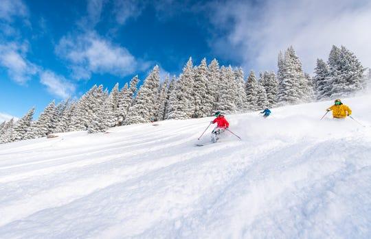 Skiers enjoy the slopes at Vail Ski Resort in Colorado.