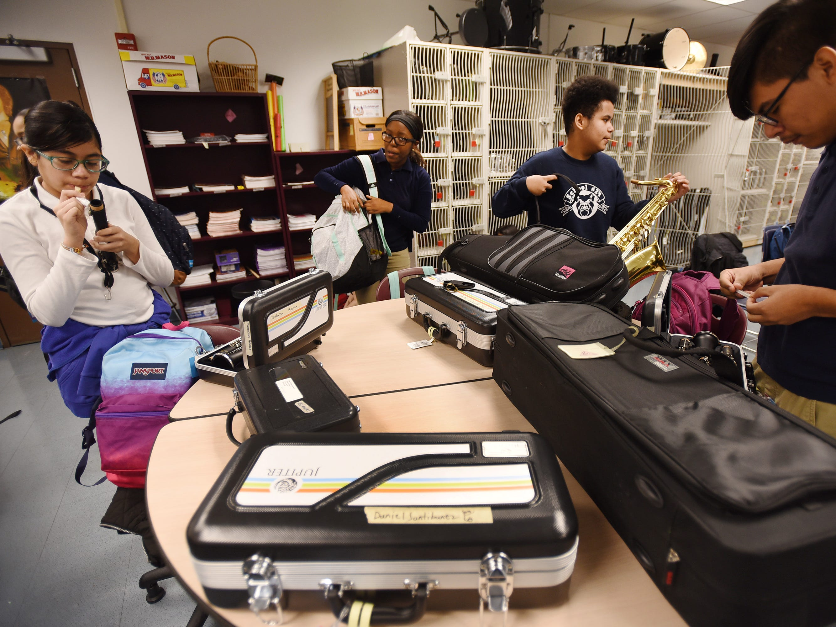 Sixth grader Isabella Rodas (L), prepares her clarinet prior to practice led by the Band Director Nancy Horowitz at School #24 in Paterson on 01/09/19.
