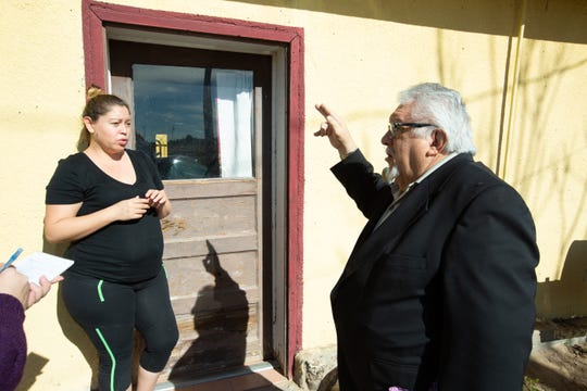 Doña Ana County Commissioner Ramon Gonzalez, right, speaks on Monday, Jan. 7, 2019, with resident Laura Gallegos, who lives close to the site of a Dec. 13 gasoline spill. Gallegos, who's pregnant, has three children who also live in the home. After an evacuation in December, the family was expecting to re-evacuate, voluntarily, this week, which Gallegos says is an inconvenience.